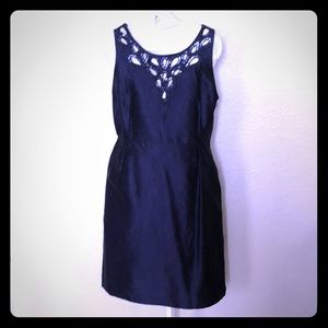 Navy dress with pockets and sequins.